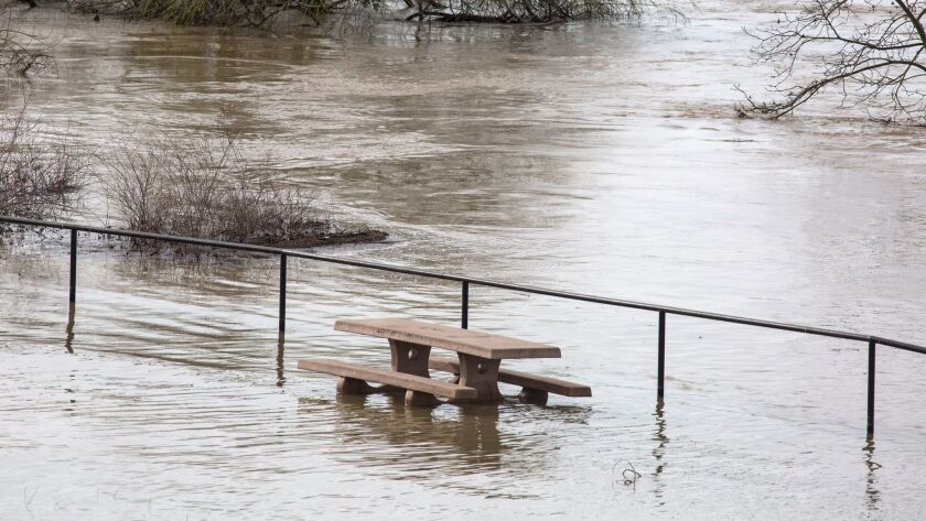 Flood water inundates a picnic area along the Feather River downstream from at Lake Oroville Dam in Oroville, Calif., on Feb. 13.