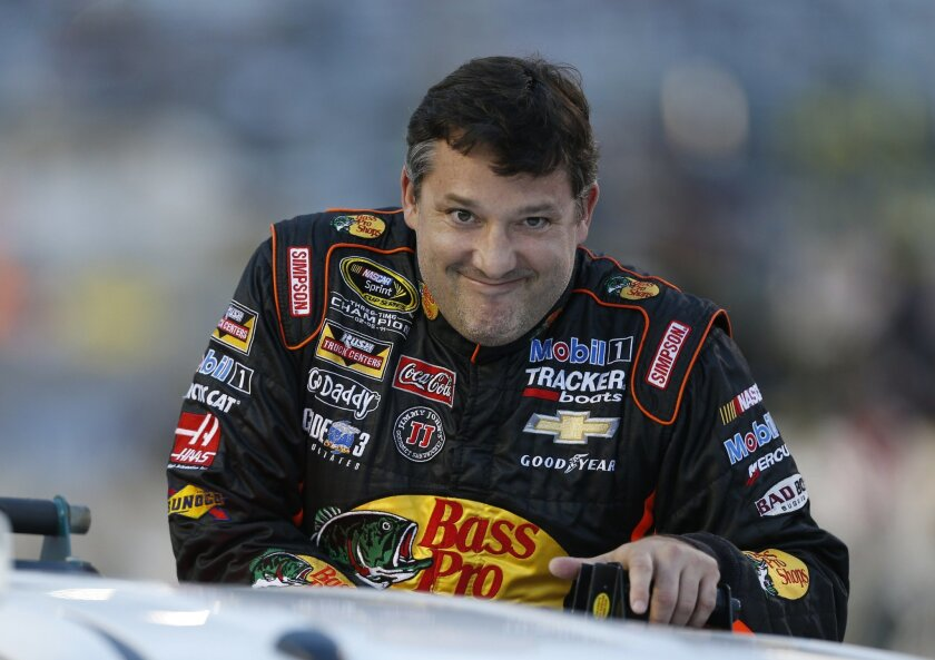 Tony Stewart looks to the crowd during driver introductions prior to the start of the NASCAR Sprint Cup race at Richmond International Raceway in Richmond, Va., Saturday, Sept. 6, 2014. (AP Photo/Steve Helber)