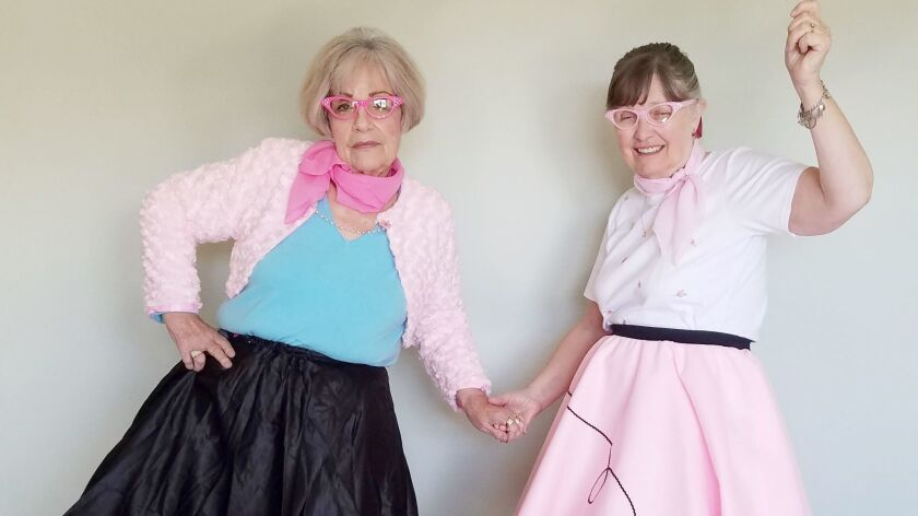 "San Vicente Valley Club members Kaaren Thiem and Maxine McNamara dress for the ""Shake, Rattle, and Roll Sock Hop."""