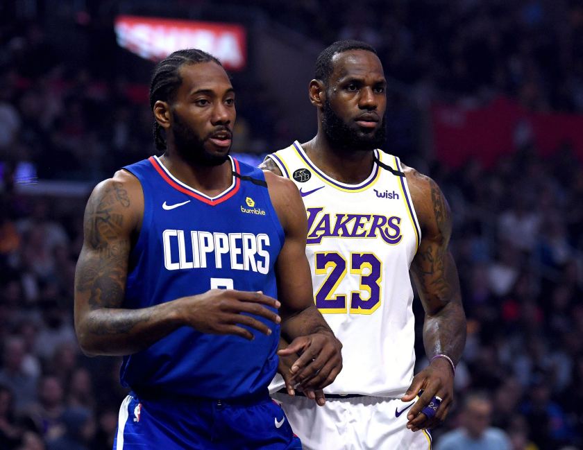 Clippers forward Kawhi Leonard and Lakers forward LeBron James stand next to one another during a game in March.