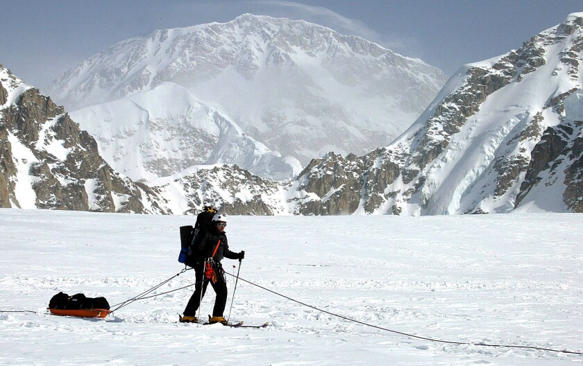 A skier moves across the Kahiltna Glacier in Alaska with Mt. McKinley in the background in 2002.