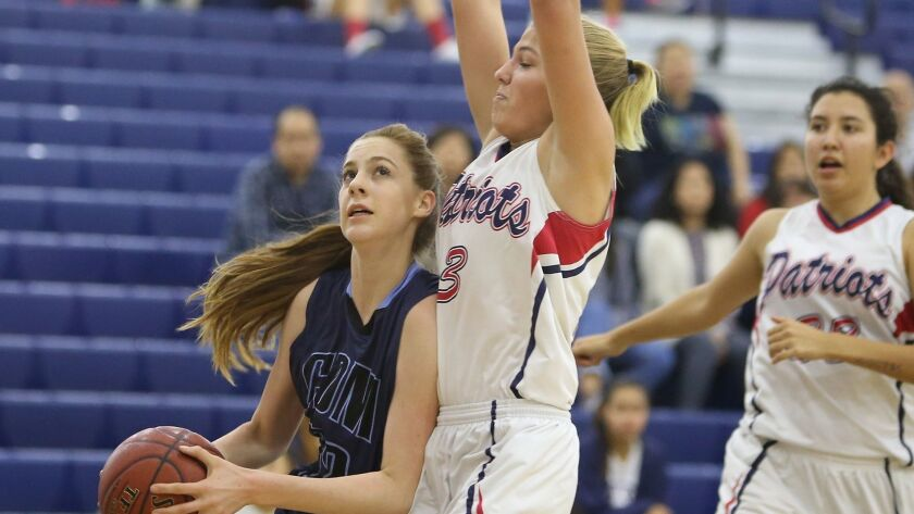 CDM's Tatiana Bruening, left, makes move on Beckman's Alyssa Braunstein in the post in girls varsity