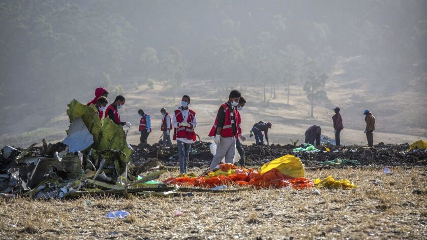 Rescuers work at the scene where an Ethiopian Airlines jet crashed on March 11, 2019.