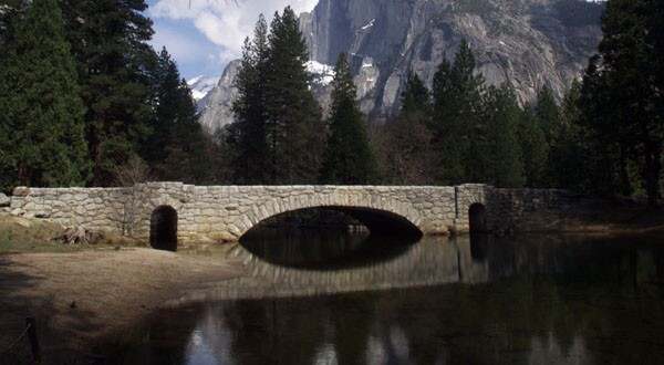 The historic Stoneman Bridge spans the Merced River in Yosemite National Park. Three of the park's bridges are facing removal.