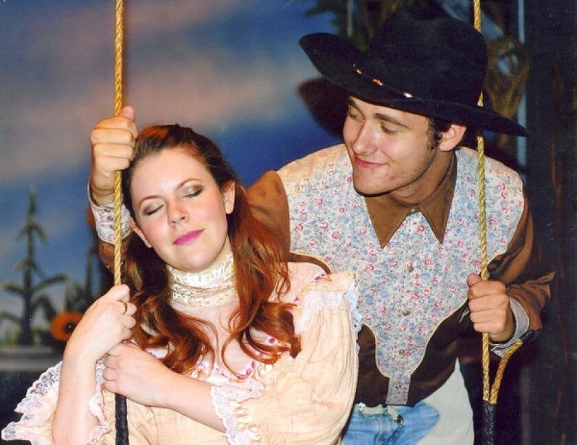 Luke Carlsen woos Andrea Dennison-Laufer in the musical comedy ¿Oklahoma!¿ at the Newport Theatre Arts Center.