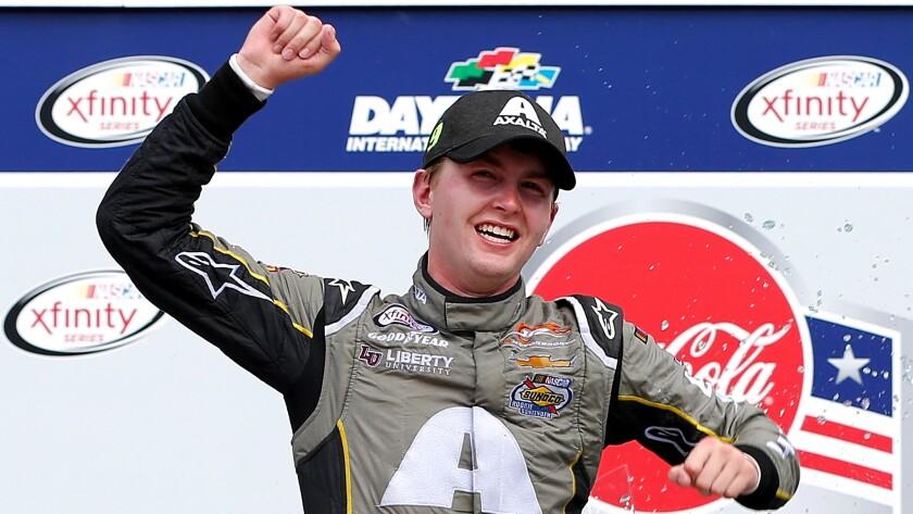 NASCAR driver William Byron celebrates after winning the Xfinity Series Coca-Cola Firecracker 250 at Daytona International Speedway on Saturday.