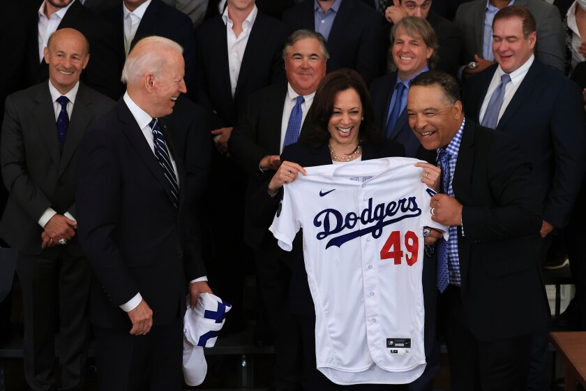 Dodgers Manager Dave Roberts presents Vice President Kamala Harris with a jersey