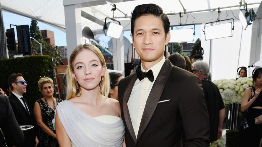 Sydney Sweeney, left, and Harry Shum Jr. at the 25th Screen Actors Guild Awards at the Shrine Auditorium on Sunday in Los Angeles.