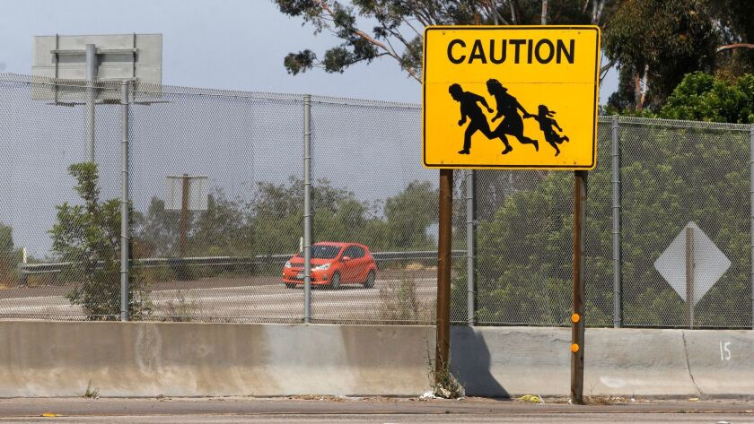 "The last of ten ""immigrant crossing"" signs that once stood on either side of Interstates 5 and Interstate 805 near the US-Mexico border is gone."