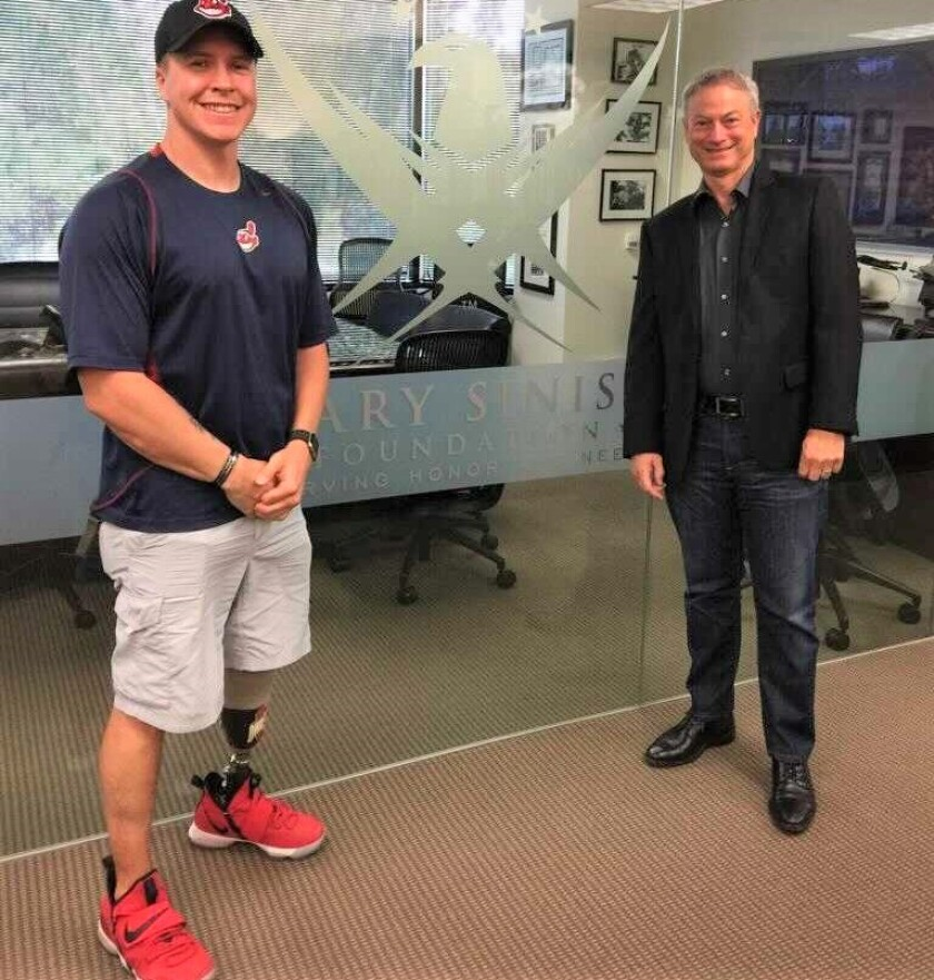 """Daniel """"Doc"""" Jacobs, retired Navy combat vet, is with Gary Sinise, whose foundation has built Jacobs an adapted smart house."""