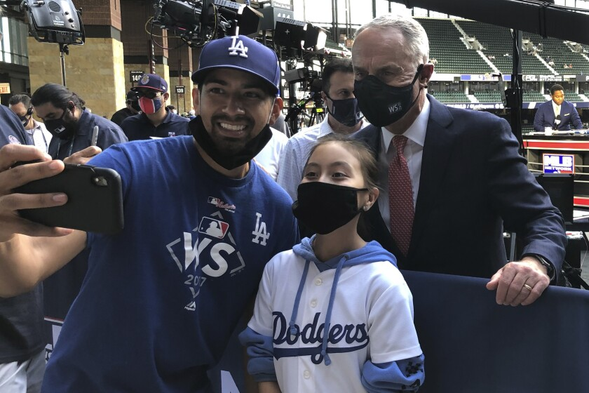MLB Commissioner Rob Manfred poses with fans before Game 1 of of the 2020 World Series.