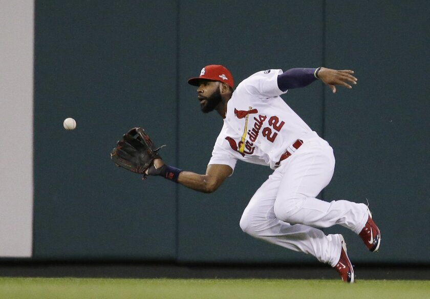 FILE - In this Oct. 9, 2015, file photo, St. Louis Cardinals right fielder Jason Heyward prepares to catch a ball hit by Chicago Cubs' Addison Russell during the third inning of Game 1 in baseball's National League Division Series in St. Louis. Heyward is among the top players to join the NL Centra