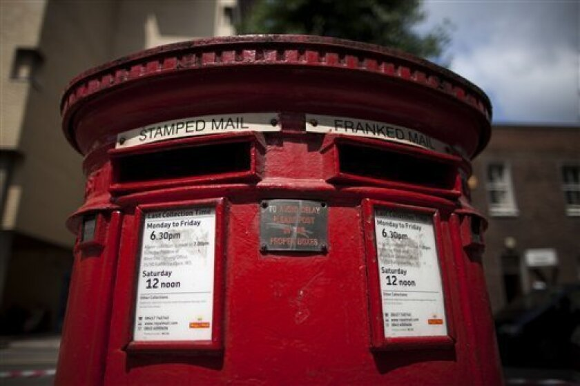 A postbox stands in London, Wednesday, July 10, 2013. The British government will lay out plans to privatize the Royal Mail in a 3 billion pounds ($4.5 billion) share offering that will see tens of thousands of workers get a stake in the company. The Communications Workers Union is opposed to the privatization amid fears that it will lead to job losses and lower wage increases. (AP Photo/Matt Dunham)