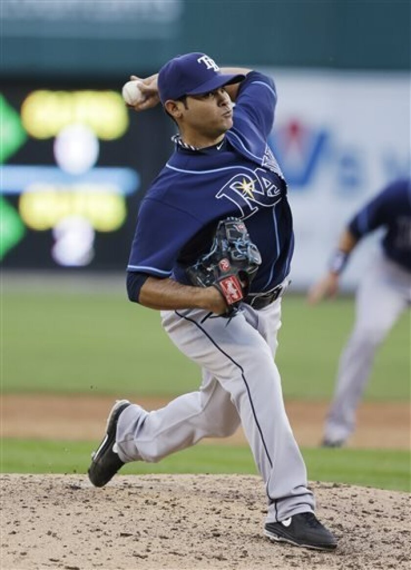 Tampa Bay Rays relief pitcher Alex Torres throws during the third inning of a baseball game against the Detroit Tigers in Detroit, Tuesday, June 4, 2013. (AP Photo/Carlos Osorio)