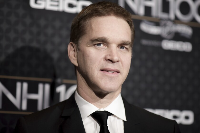 Luc Robitaille in a suit