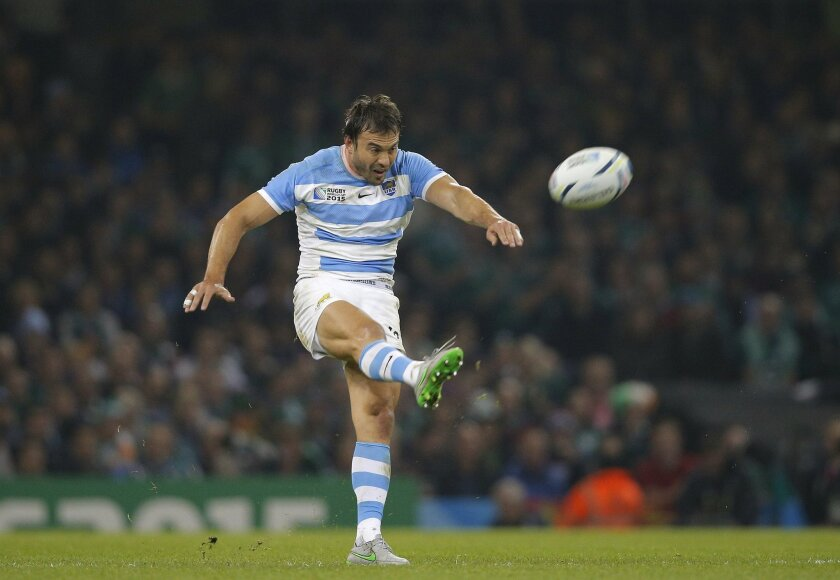FILE - In this Oct. 18, 2015 file photo, Argentina's Juan Martin Hernandez kicks the ball during the Rugby World Cup quarterfinal match between Ireland and Argentina at the Millennium Stadium in Cardiff. Despite an unavoidably hectic travel schedule, Argentina's stocks in world rugby are expected t