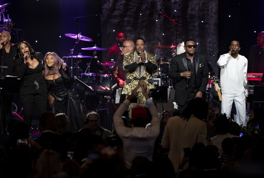 """Faith Evans, from left, Lil' Kim, Mase, Carl Thomas and Christian """"King"""" Combs perform during a tribute to Sean """"Diddy"""" Combs."""