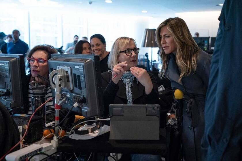 """Mimi Leder, center, and Jennifer Aniston, right, on the set of """"The Morning Show."""""""