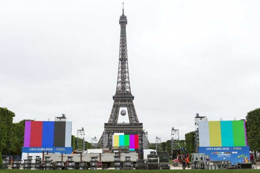 The Euro 2016 Paris Fan Zone is under construction on the Champs de Mars, with a giant screen and the Eiffel Tower on the background, in Paris, France, Friday, June 3, 2016. France's interior minister says the Paris police chief wants more security staff to protect fans at the 2016 European Champio