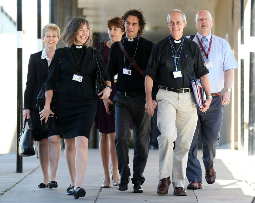 The Archbishop of Canterbury, Justin Welby, second right, and unidentified members of the clergy, arrive for the General Synod meeting, at The University of York, in York England, Monday July 14, 2014. The Church of England is set to vote on whether women should be allowed to enter its top ranks as bishops. The Church's national assembly, known as the General Synod, is meeting in York, northern England, where it will debate the issue ahead of a vote Monday. (AP Photo/PA, Lynne Cameron) UNITED KINGDOM OUT