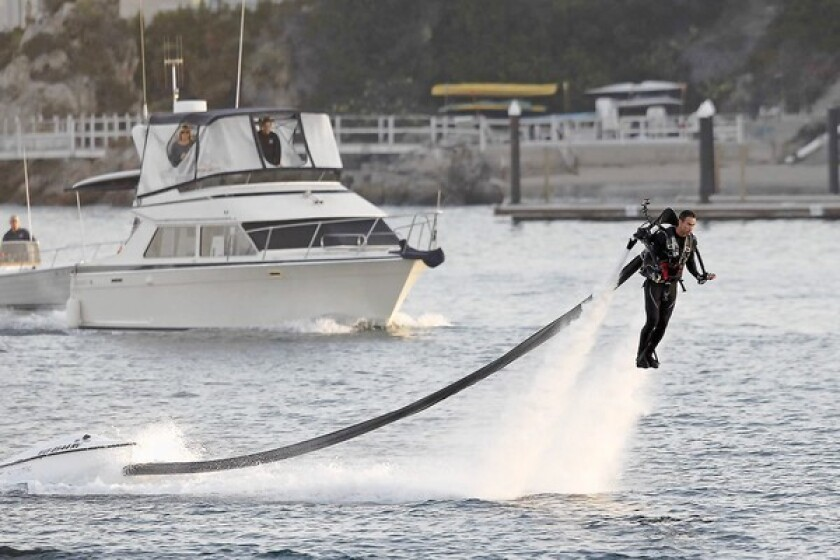 Jetlev Southwest President Dean O'Malley pilots a jetpack as he departs Newport Beach in an attempt to set a world record for longest jetpack flight, a 26.2-mile journey to Catalina Island on Saturday morning.