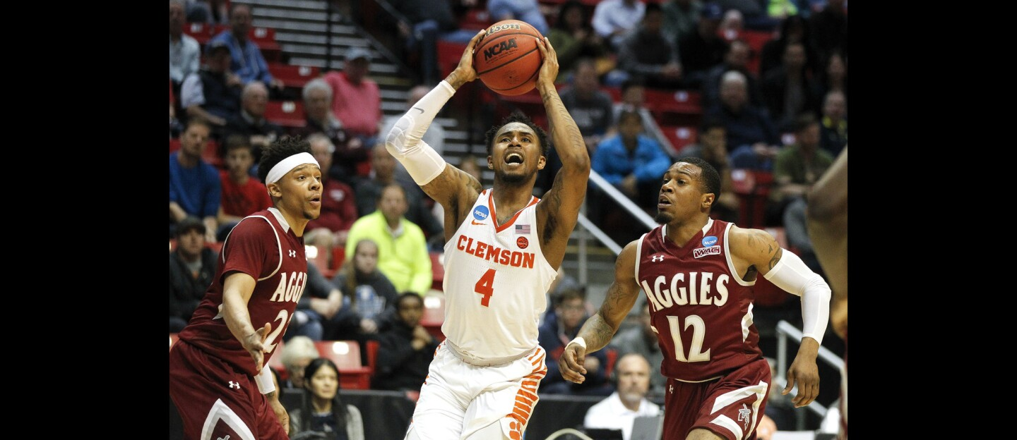 Clemson's Shelton Mitchell shoots while pressured by New Mexico State's Zach Lofton, left, and AJ Harris in the second half.