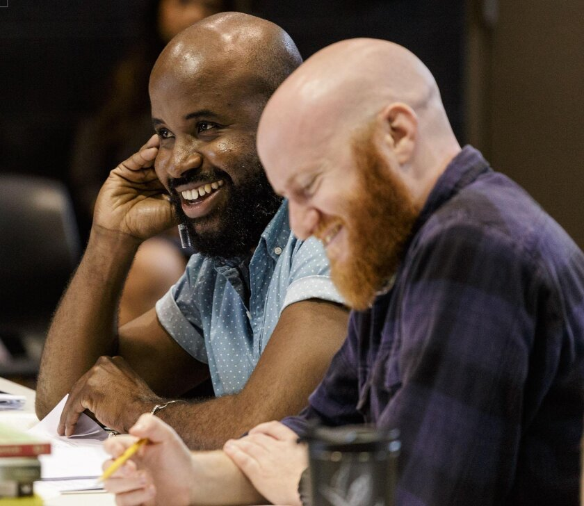 Playwright Jeff Augustin (left) and director Joshua Kahan Brody work on the Playhouse's world premiere of 'The Last Tiger in Haiti.'