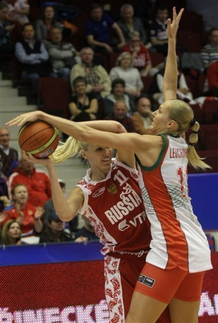 Maria Stepanova, left, from Russia is challenged by Yelena Leuchanka, right, from Belarus during their World Basketball Championship quarter final match in Karlovy Vary, Czech Republic, Friday, Oct. 1, 2010. (AP Photo/Petr David Josek)