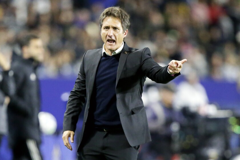 Galaxy coach Guillermo Barros Schelotto reacts to a call on the sideline during a match.
