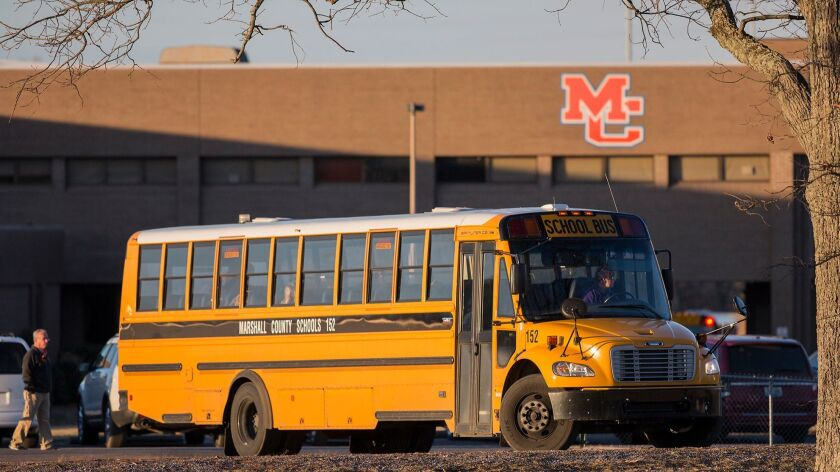 A school bus leaves Marshall County High School in Benton, Ky., Friday, Jan. 26, 2018, on the first