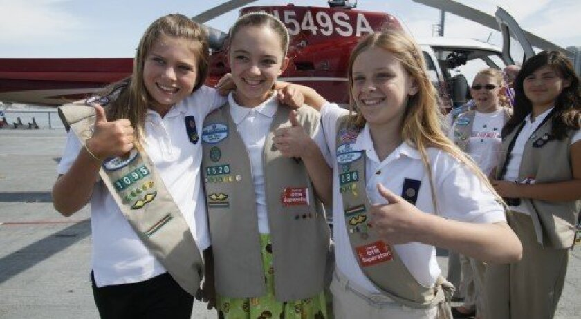 From left, Girl Scouts Melissa Thomas of Rancho Santa Fe (3,009 boxes), Caroline Sanborn of Carmel Valley (2,012 boxes) and Roni Nelson of Rancho Santa Fe (4,082 boxes).