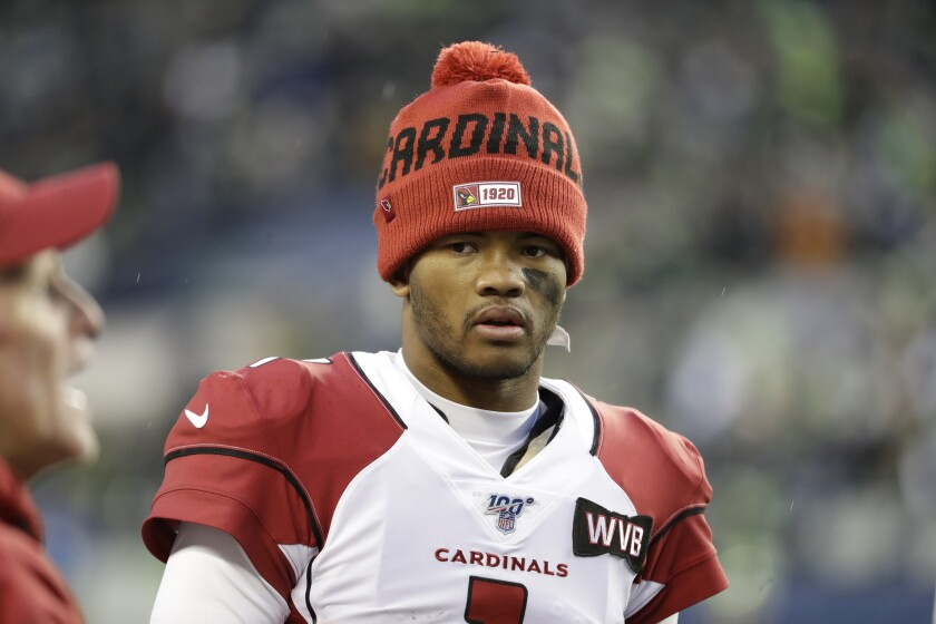 Arizona Cardinals starting quarterback Kyler Murray stands on the sideline
