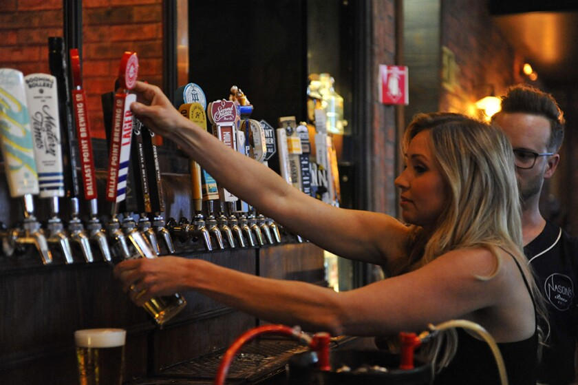 Celebrity reporter Heather Lake pours a beer at Nason's Beer Hall Bartending Charity Event in April 2019.