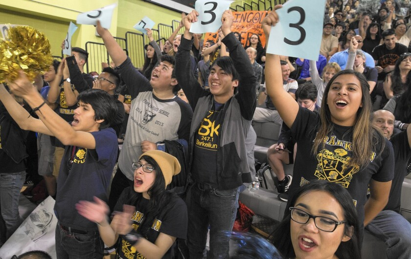 Franklin High School students cheer their team in the academic decathlon known as the Super Quiz.