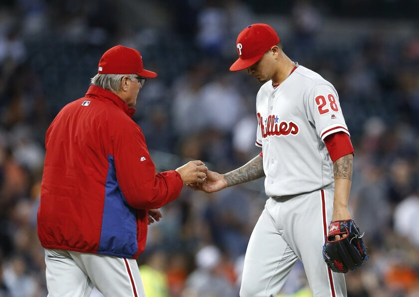 Philadelphia Phillies manager Pete Mackanin takes the ball from pitcher Vince Velasquez in the fifth inning of a baseball game against the Detroit Tigers, Monday, May 23, 2016 in Detroit. (AP Photo/Paul Sancya)