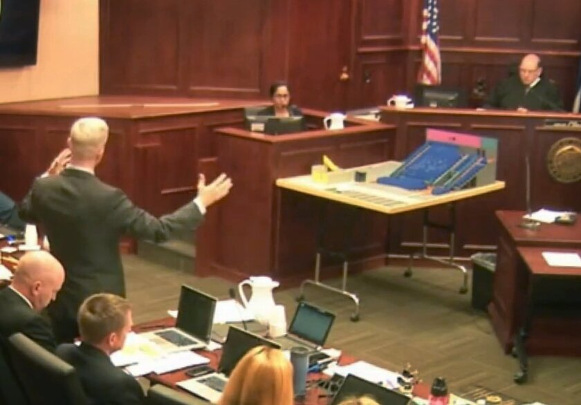 CORRECTS NAME OF DISTRICT ATTORNEY GEORGE BRAUCHLER  In this image made from video, Gargi Datta, a former girlfriend of Colorado theater shooter James Holmes, is questioned by District Attorney George Brauchler, during a trail for Holmes, Thursday, June 11, 2015, in Centennial, Colo. Datta testifie