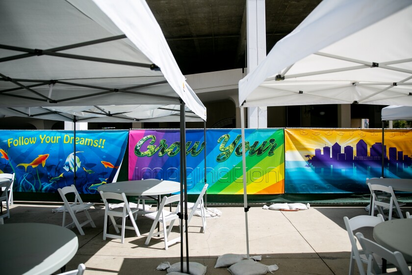 Banners created by the San Diego Opera hang in the outdoor area of the family homeless shelter at Golden Hall on July 5, 2019 in San Diego, California.