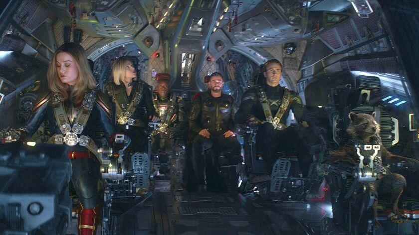 """From left, Brie Larson, Scarlett Johansson, Don Cheadle, Chris Hemsworth, Chris Evans and Rocket, voiced by Bradley Cooper, in """"Avengers: Endgame."""""""