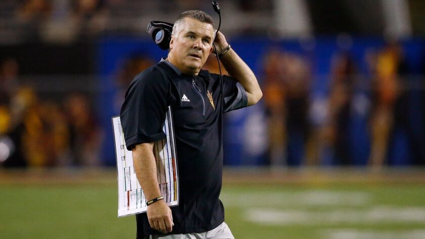FILE - In this Sept. 9, 2017, file photo, Arizona State coach Todd Graham stands on the field during