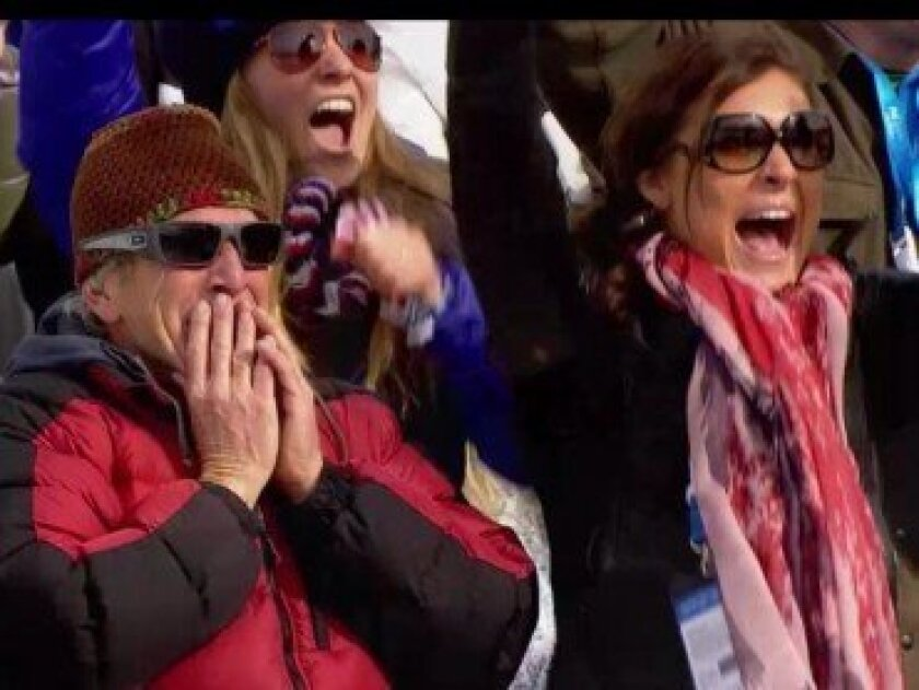 Corrie Anderson (right) cheers for her sister Jamie at the Sochi Winter Olympics. Courtesy photos