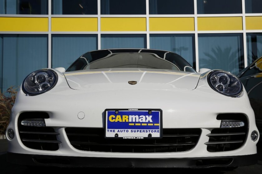 A Porsche on display at a CarMax store in Burbank.