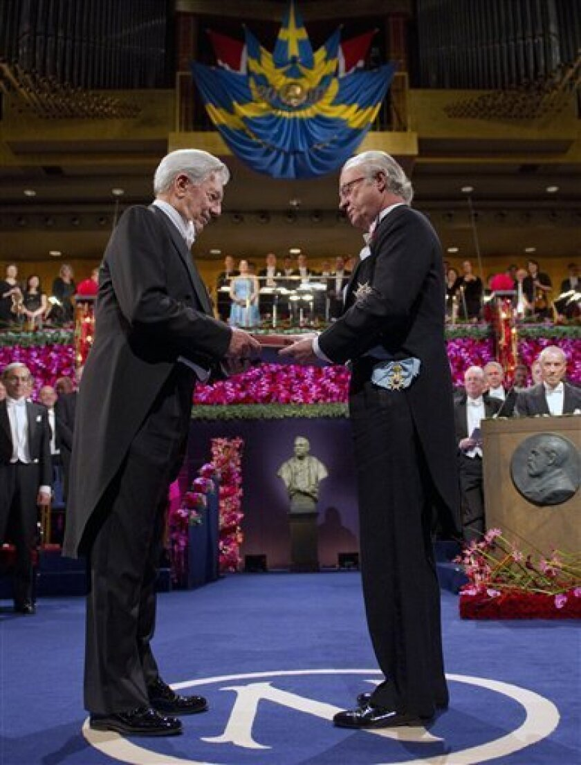 FILE - In this Dec. 10, 2010 file photo, Peruvian Nobel literature laureate Mario Vargas Llosa, left, receives the Nobel Prize in Literature from Swedish King Carl XVI Gustaf, right, at the Concert Hall in Stockholm. Scientists, writers and brokers of peace around the world will be holding their breaths for a potentially life-altering, $1.5 million phone call from Scandinavia next week. Goran Hansson, secretary of the Nobel committee for medicine, will dial the first one. He will announce the first of the 2011 Nobel Prizes on Monday, Oct. 3, 2011 after he calls the winners. (AP Photo/Scanpix Sweden, Henrik Montgomery) SWEDEN OUT