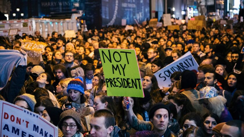 People protest the presidential election results in New York. Protesters filled 5th Avenue for five blocks, essentially closing down part of midtown Manhattan.
