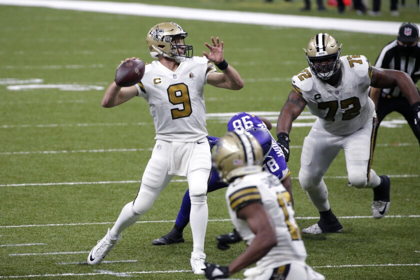 New Orleans Saints quarterback Drew Brees (9) passes under pressure from Minnesota Vikings defensive end D.J. Wonnum (98) in the second half of an NFL football game in New Orleans, Friday, Dec. 25, 2020. (AP Photo/Butch Dill)