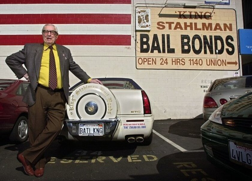 "George ""King"" Stahlman stands by his famous Cadillac next to his downtown San Diego bail bonds office in this 2003 file photo. The bumper sticker reads ""My child was citizen of the month at King Stahlman Bail Bonds."" (Union-Tribune file photo)"