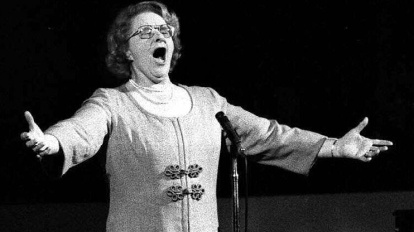 """Kate Smith sings """"God Bless America"""" before a Stanley Cup playoff game between the New York Islanders and the Philadelphia Flyers on May 13, 1975."""