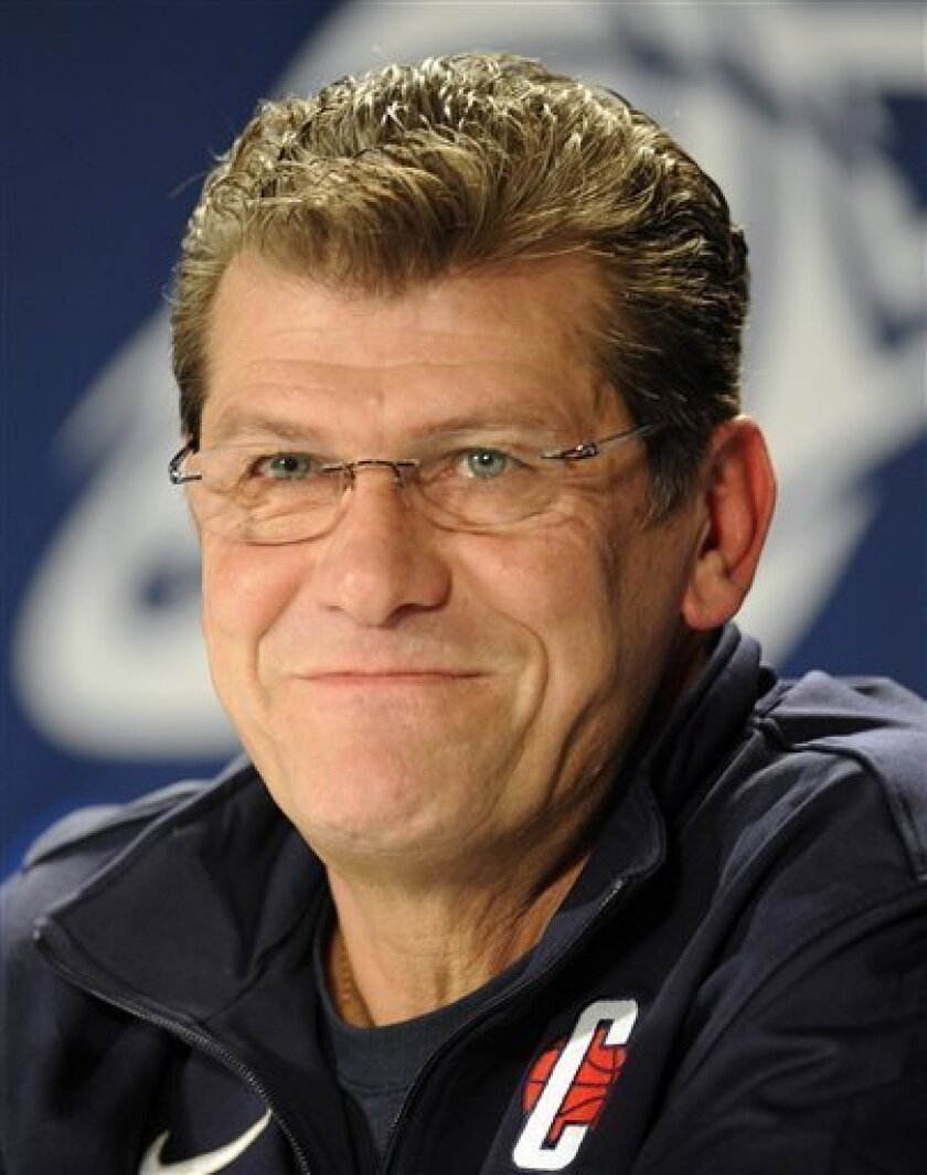 Connecticut coach Geno Auriemma smiles during a news conference before practice for an NCAA women's college basketball tournament regional semifinal, Saturday, March 26, 2011, in Philadelphia. Connecticut plays Georgetown on Sunday. (AP Photo/Barbara Johnston)