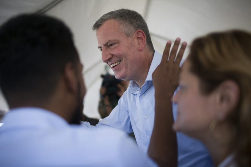 New York city Mayor Bill de Blasio greets supporters during a protest in San Juan, Puerto Rico, Thursday, Nov. 5, 2015.   York Gov. Andrew Cuomo and New York City Mayor Bill de Blasio marched on Thursday with thousands of demonstrators in Puerto Rico to support their demand for equal treatment on f