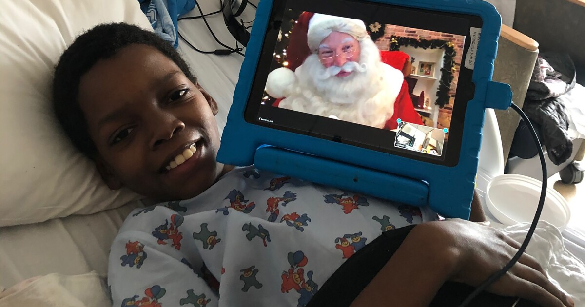 L.A.'s children's hospitals welcome Santa, with a Zoom link to the North Pole and a mask under his beard