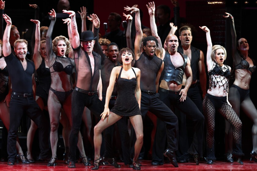 """Samantha Barks, center, as Velma Kelly in the Los Angeles Philharmonic's performance of the musical """"Chicago,"""" directed by Brooke Shields, with musical director and conductor Rob Fisher at the Hollywood Bowl."""